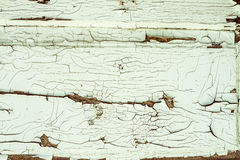 Old wooden wall with old peeled-off paint Stock Photography