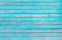 Old wooden wall painted blue, weathered wooden background with nails and slits royalty free stock images