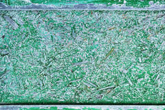 Old wooden wall painted in bright green color. Closeup Stock Image