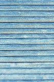 Old wooden wall painted faded blue color Royalty Free Stock Image