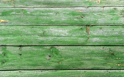 Old wooden wall, painted in green color Royalty Free Stock Photo