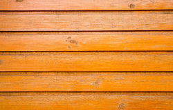 Old wooden wall. Painted orange Royalty Free Stock Images