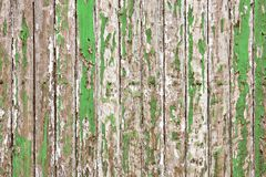 Old wooden wall painted with pale green color peeling revealed rustic texture. The old wooden wall painted with pale green color cracking, peeling and revealed Stock Photography