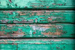old wooden wall peeling green paint stock photo