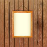 Old wooden wall with a picture in the frame with a white backgro Royalty Free Stock Photo