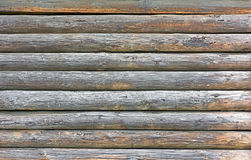 Old wooden wall of pine logs. Stock Photo