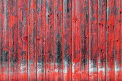 Old wooden wall with red paint. Wooden background with texture amazing texture and chaotic color pattern. Aged from time.  stock photo