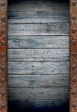 Old wooden wall in rusty metal frame Royalty Free Stock Photos