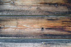 Old wooden wall with rusty nails, dark brown texture Royalty Free Stock Image