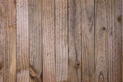 Old Wooden Wall with Vertical Slats. Old rustic wooden wall with vertical slats Royalty Free Stock Images