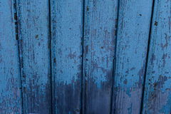 Old wooden wall. Very old wooden house wall with a shabby blue paint Stock Image