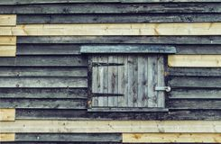 Old wooden wall with window Royalty Free Stock Photography