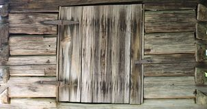 Old wooden wall with window shutter Royalty Free Stock Images