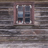 Old wooden wall with window Royalty Free Stock Image
