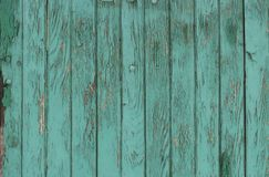 The old wooden walls painted green. Old wooden wall background or texture. Old wooden wall background or texture The old wooden walls painted green royalty free stock images