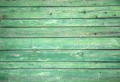 The old wooden walls painted green. Old wooden wall background or texture. Old wooden wall background or texture The old wooden walls painted green royalty free stock photos