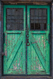 Old wooden warehouse door with a crane hook in front Stock Image