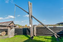 Old wooden water crane well in village Royalty Free Stock Image