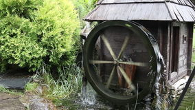 Old wooden water mill. Vintage stock footage