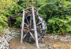 Old wooden water mill wheel Stock Photo
