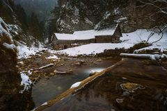 Old wooden water mill in winter. Old wooden water mill at National Nature Reserve Kvacianska dolina in Slovakia in winter.  It has been restored and serves as a Royalty Free Stock Images