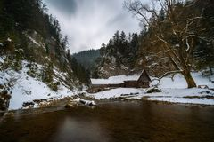 Old wooden water mill in winter Stock Images