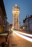 Old wooden water tower in Siofok, Hungary. SIOFOK, HUNGARY - AUGUST 24, 2016: Old wooden water tower on main square of city Siofok with night illumination Royalty Free Stock Image