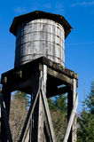 Old wooden water tower under blue sky Royalty Free Stock Images