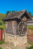 Old wooden water well house in Bucovina, Romania. Old wooden house used to protect the water well in Bucovina, Romania Royalty Free Stock Photo