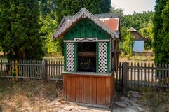 Old wooden water well in the park Royalty Free Stock Images