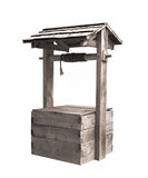 Old wooden water well with roof isolated. Royalty Free Stock Image