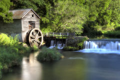 Old Wooden Water Wheel Mill, HDR. High Dynamic Range (HDR) image of old wooden water wheel mill and dam along forest river Royalty Free Stock Photos