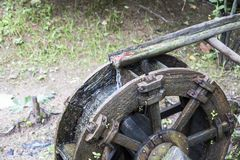 Old wooden waterwheel in the forest stock images