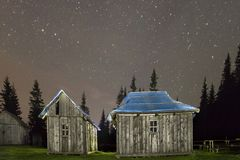 Old wooden weathered unpainted shepherd huts on Carpathian mount royalty free stock photography