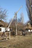Old wooden well Crane. Ukrainian village. Stock Photos
