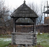 Old wooden well in Maramures. Traditional wooden well in Maramures Stock Photography