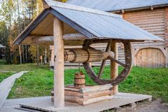 Old wooden well with a wheel. In the museum Small Korely royalty free stock image
