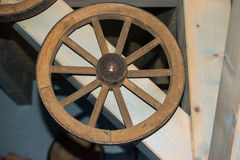 Old Wooden wheel / Altes antikes Holzrad. Old Wooden wheel in barn stock images