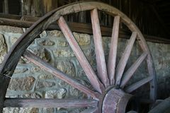 The old wooden wheel in the barn. Royalty Free Stock Photography