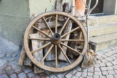 Old wooden wheel of carriage, against wall royalty free stock photo