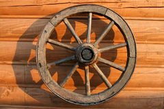Old wooden wheel from a cart Royalty Free Stock Photo