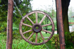 Old wooden wheel from a cart in village Royalty Free Stock Photo
