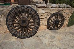 Old wooden wheel close-up outdoors Royalty Free Stock Photo