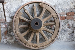 Old wooden wheel in the farm Royalty Free Stock Photo