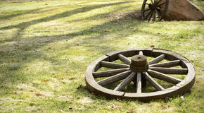 Old wooden wheel. Is on the ground Stock Photography