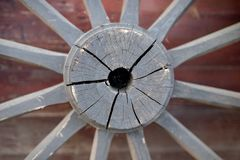 An old wooden wheel from a ladder. Wheel from a wooden wagon fro. M ancient times. Season of the autumn stock photography