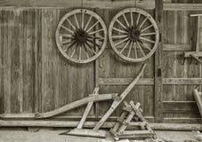 Old wooden wheelbarrow in farm house. Autumn harvest background Stock Photos
