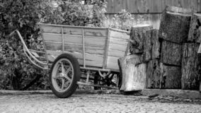 Old wooden wheelbarrow on the side of the road. In the village of Bellwald in the famous Fischertal Valais, Switzerland a wooden wheelbarrow is standing next to stock photos