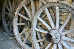 Old wooden wheels. Old wagon wheel with spokes royalty free stock photos