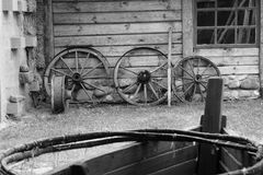 Old wooden wheels of cart. Royalty Free Stock Images